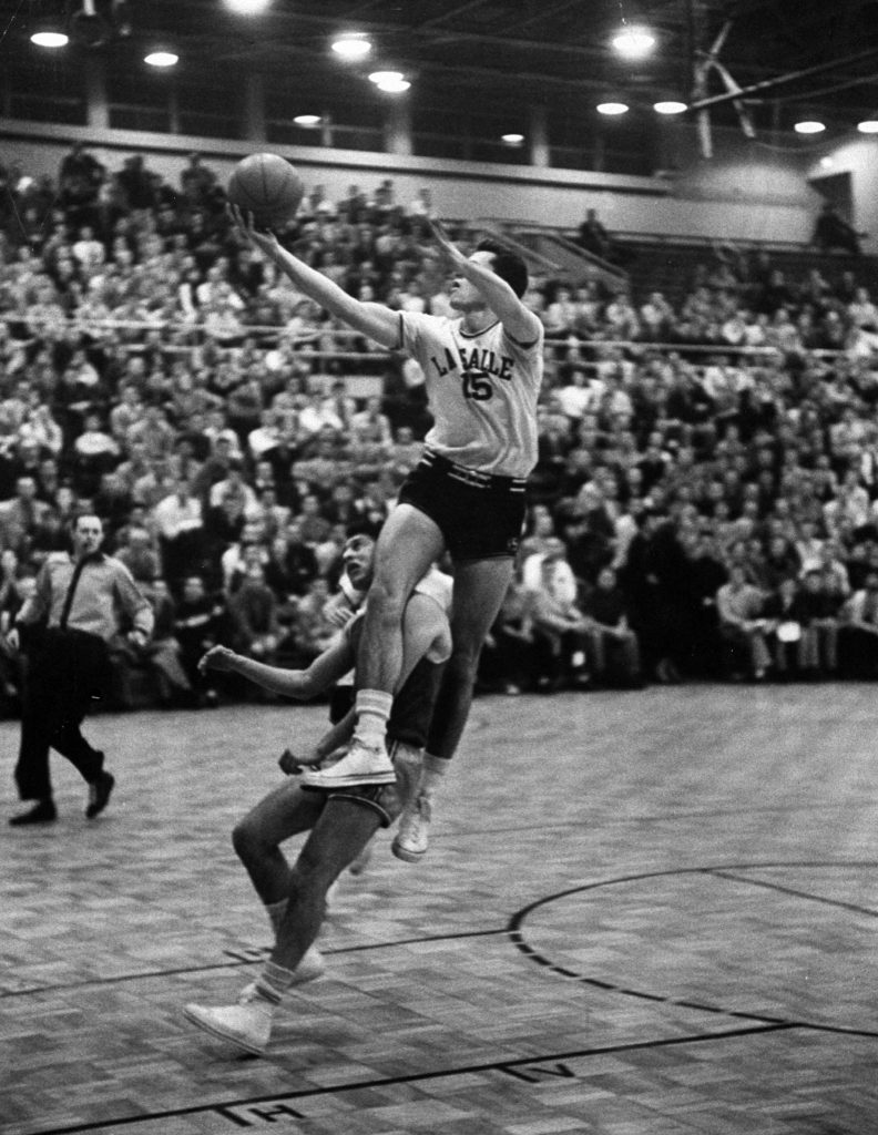 La Salle's Tom Gola (above, driving to the hoop in 1954) was one of the college game's earliest superstars, a do-it-all forward who still holds the Division I record for career rebounds (2,201). The four-time All-American also scored 2,462 points, for career averages of 20.9 points and 18.7 rebounds.