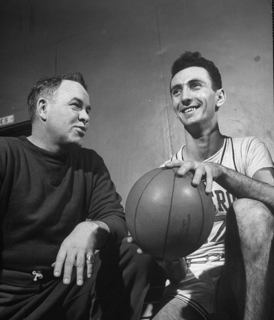 Bob Cousy (above, at right, in 1950 when he was with Holy Cross) brought a showman's flair to the sport before it was an accepted part of the game, regularly dribbling behind his back and throwing no-look passes. Known as the Houdini of the Hardwood, he was basketball's first great pure playmaker.