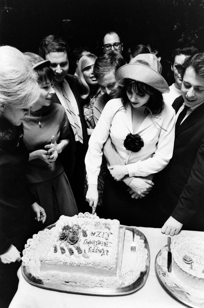 Surrounded by friends, and in the embrace of fiancé Peter Allen   she'd marry the Australian entertainer two years later   19-year-old Liza Minnelli cuts her birthday cake in 1965.