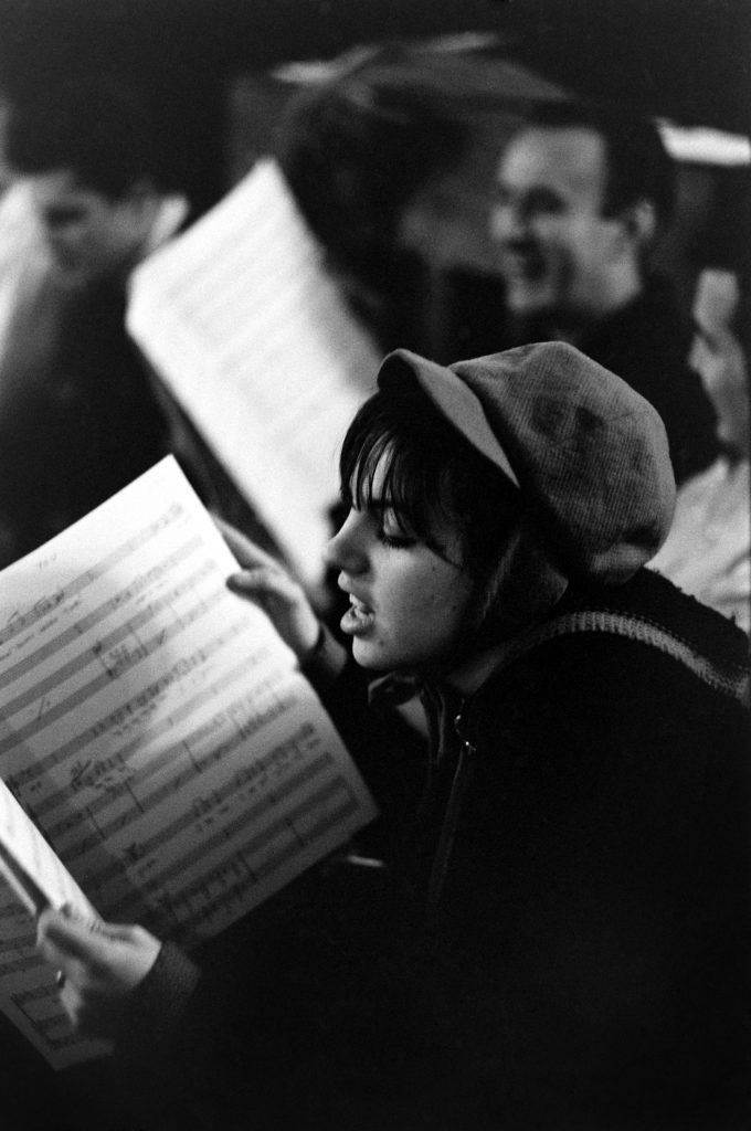 Liza Minnelli studies sheet music in rehearsals for Flora the Red Menace in 1965, a new musical in which she'd play a bohemian fashion designer during the Great Depression.