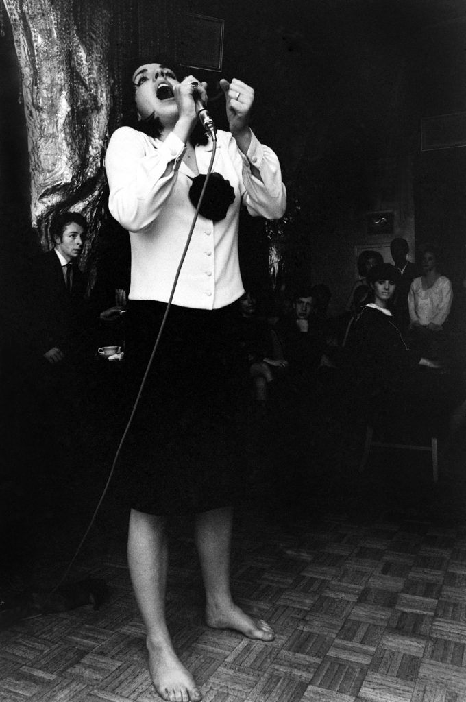 "Shoes kicked off, head thrown back, 19-year-old Liza Minnelli belts out a song for birthday party guests in 1965. From LIFE's report: ""When a friend scolded her for singing for free she said, 'I don't care, I sing for me.'"""