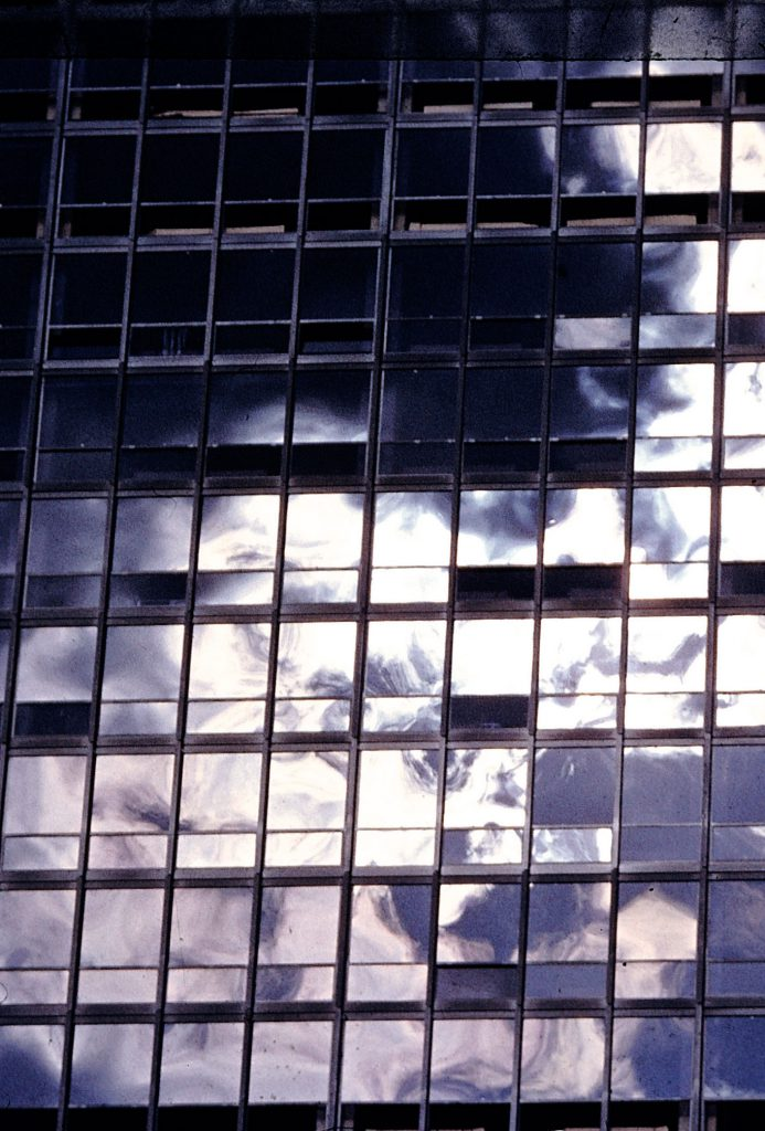 Clouds reflected on the glass facade of an apartment building in Chicago designed by Ludwig Mies van der Rohe, 1956.