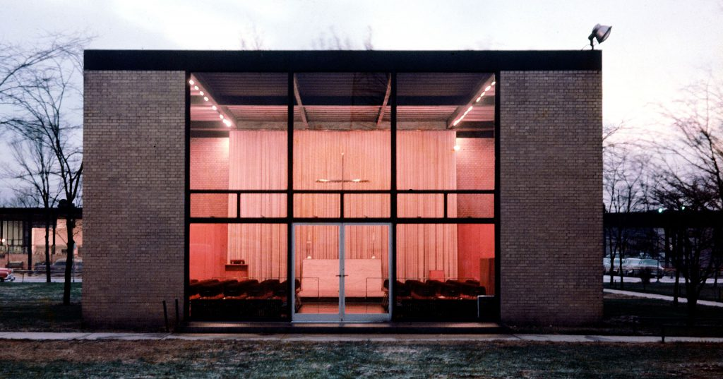 Spiritual simplicity was Mies' aim in designing the Illinois Tech Chapel. Maintaining the basic campus pattern, he insisted on flat-roofed rectangle but provided brick walls to give the chapel a sense of privacy and solitude. Steel mullions of the facade echo shape of the cross above the altar