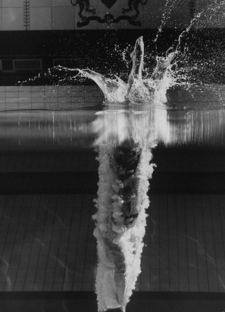 Kathy Flicker dives at Princeton University's Dillon Gym pool in 1962.