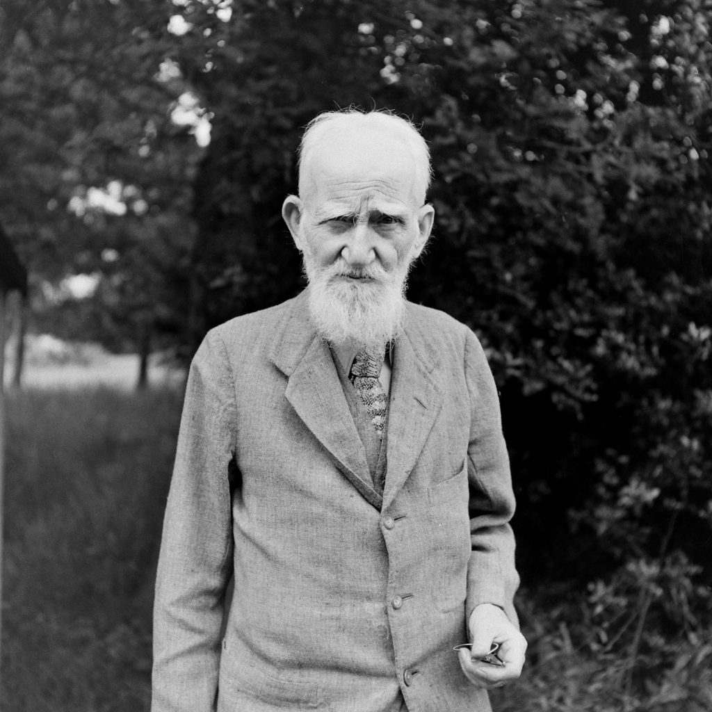 George Bernard Shaw, 90 years old, stands in the yard of his home in the Hertfordshire village of Ayot St. Lawrence, England, in 1946.