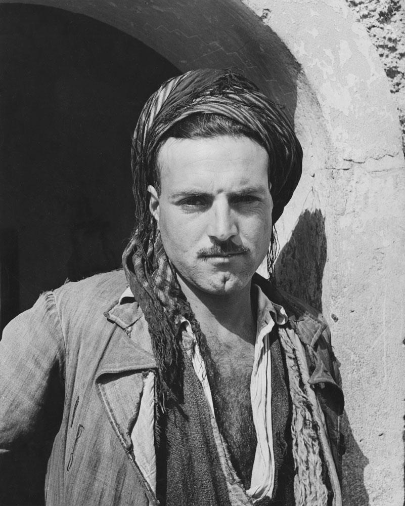 A Kurd guards the gate at Kirkuk, Iraq, 1945.