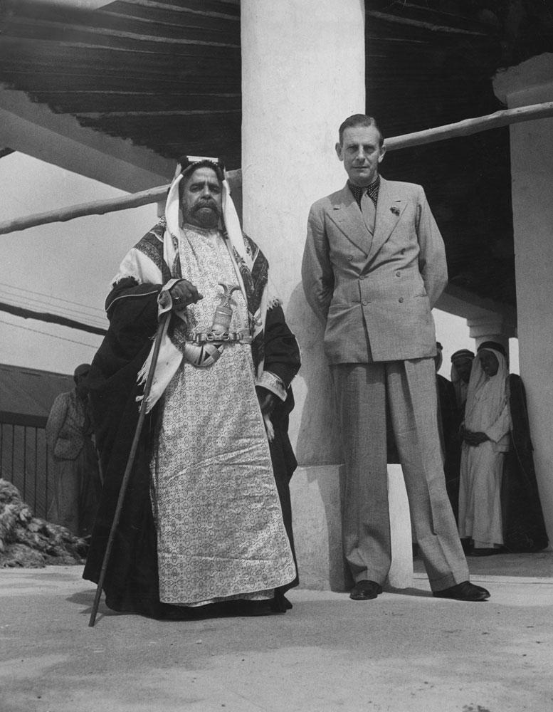 Sheik of Bahrain, Sir Sulman-Bin-Hamad-Bin Isa Al Khalifa, poses with British adviser C. Dalyrymple Belgrave, power behind the throne.