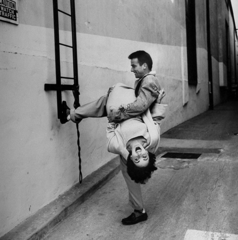 Elizabeth Taylor and Montgomery Clift goof around during a break in filming A Place in the Sun.