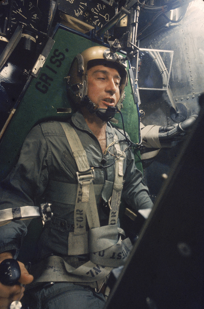 """Astronaut Virgil """"Gus"""" Grissom strapped into a centrifuge during a simulated space flight, 1959."""