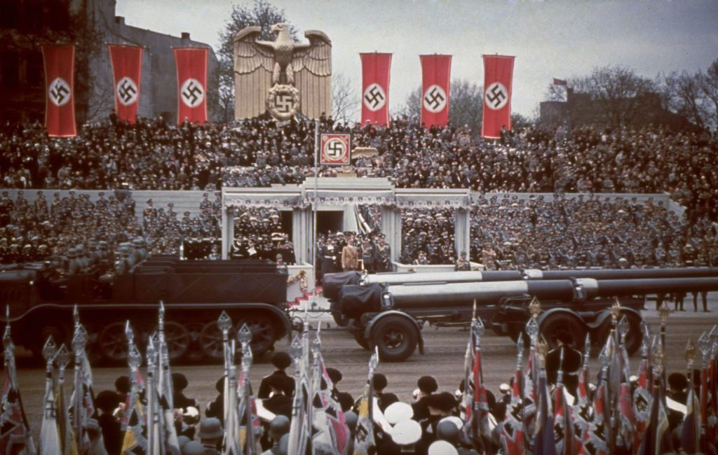 Heavy artillery passes the reviewing stand during a military parade in celebration of Adolf Hitler's 50th birthday, Berlin, April 20, 1939.