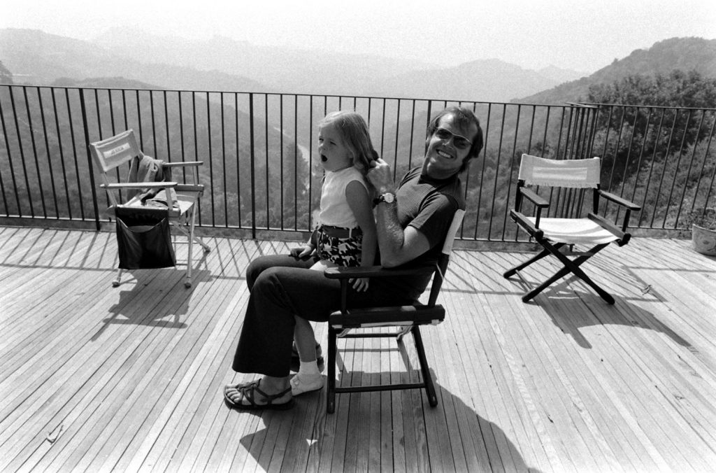 Jack Nicholson plays with his daughter, Jennifer, on the deck of his home overlooking Franklin Canyon, Los Angeles, 1969.