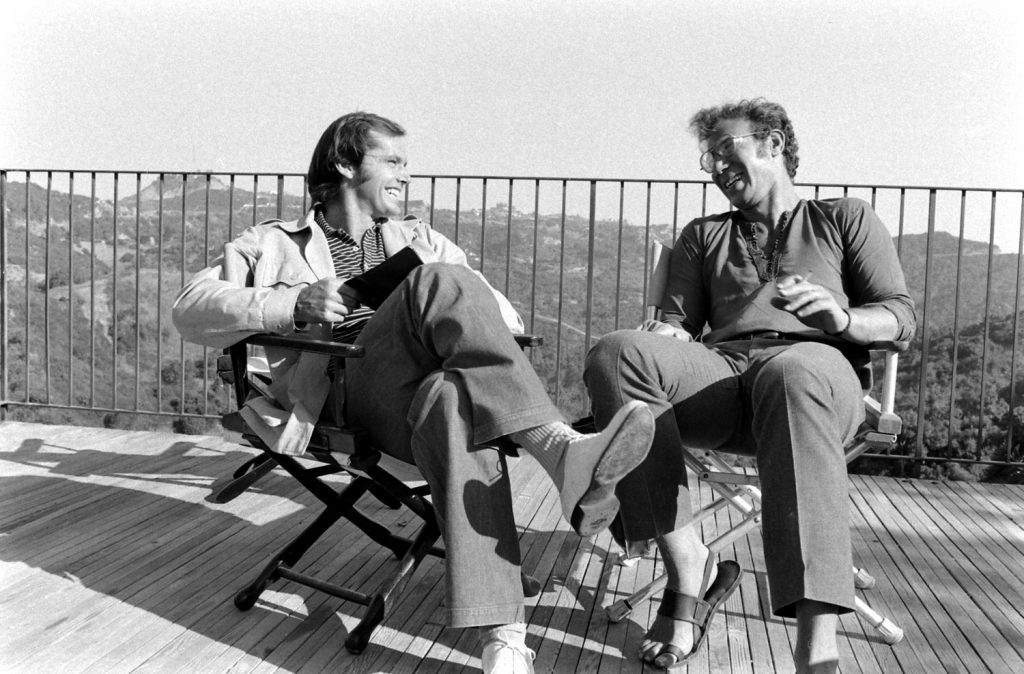 Jack Nicholson and director Bob Rafelson chat on the deck of Nicholson's home, Los Angeles, 1969.