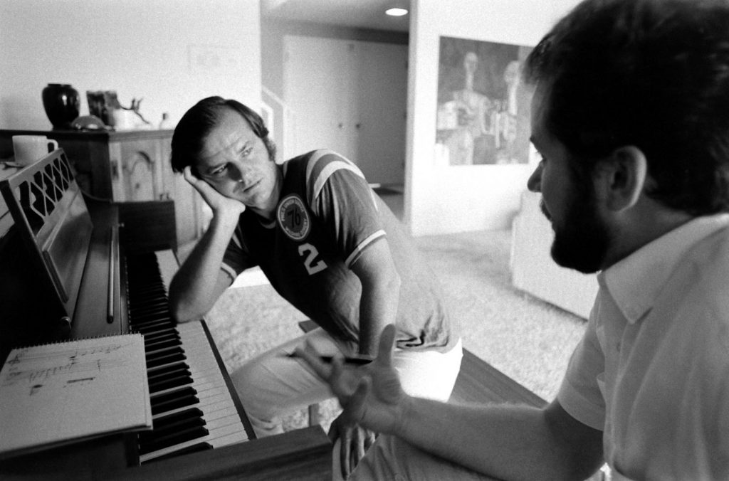 Jack Nicholson at home in 1969, taking his first piano lesson with teacher Josef Pacholczyk, prior to starring as a classical pianist-turned-roughneck in the 1970 classic, Five Easy Pieces.