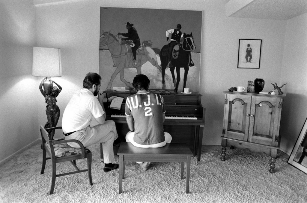 Jack Nicholson at home in 1969, taking his first piano lesson with teacher Josef Pacholczyk