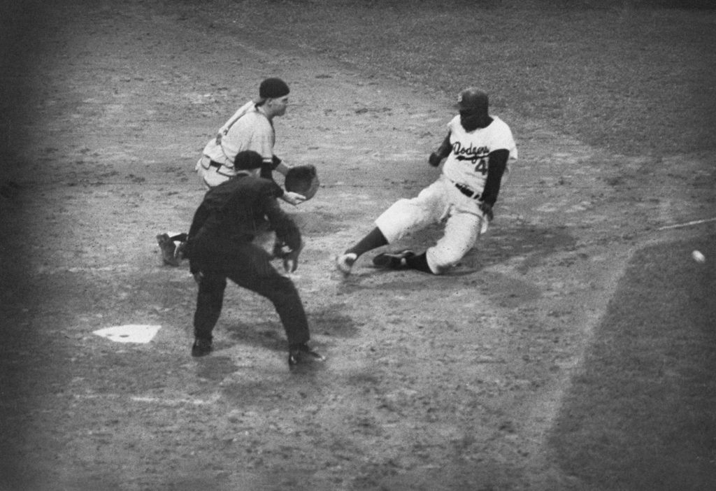 Jackie Robinson slides into home in 1956