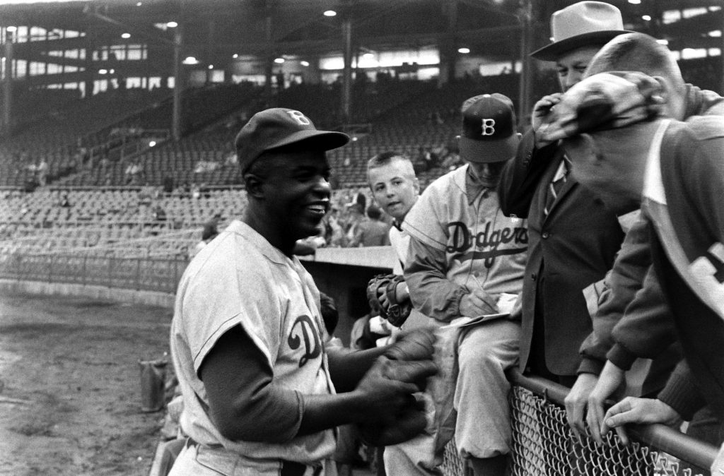Jackie Robinson chats with fans in 1955.