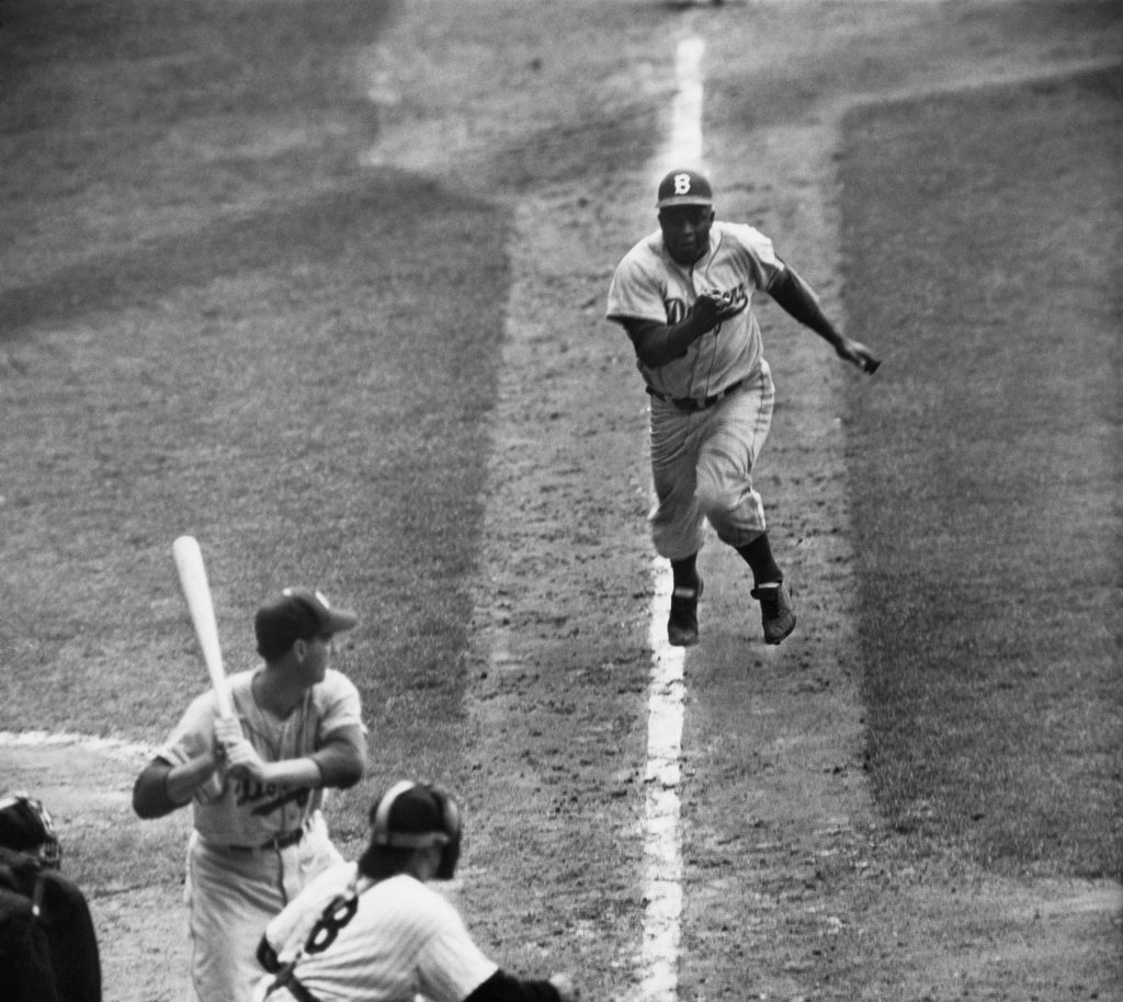 Jackie Robinson stealing home in 1955