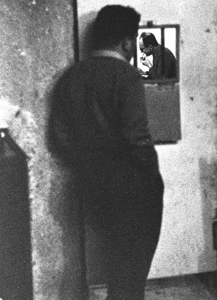 Adolf Eichmann awaits trial in Israel, 1961.