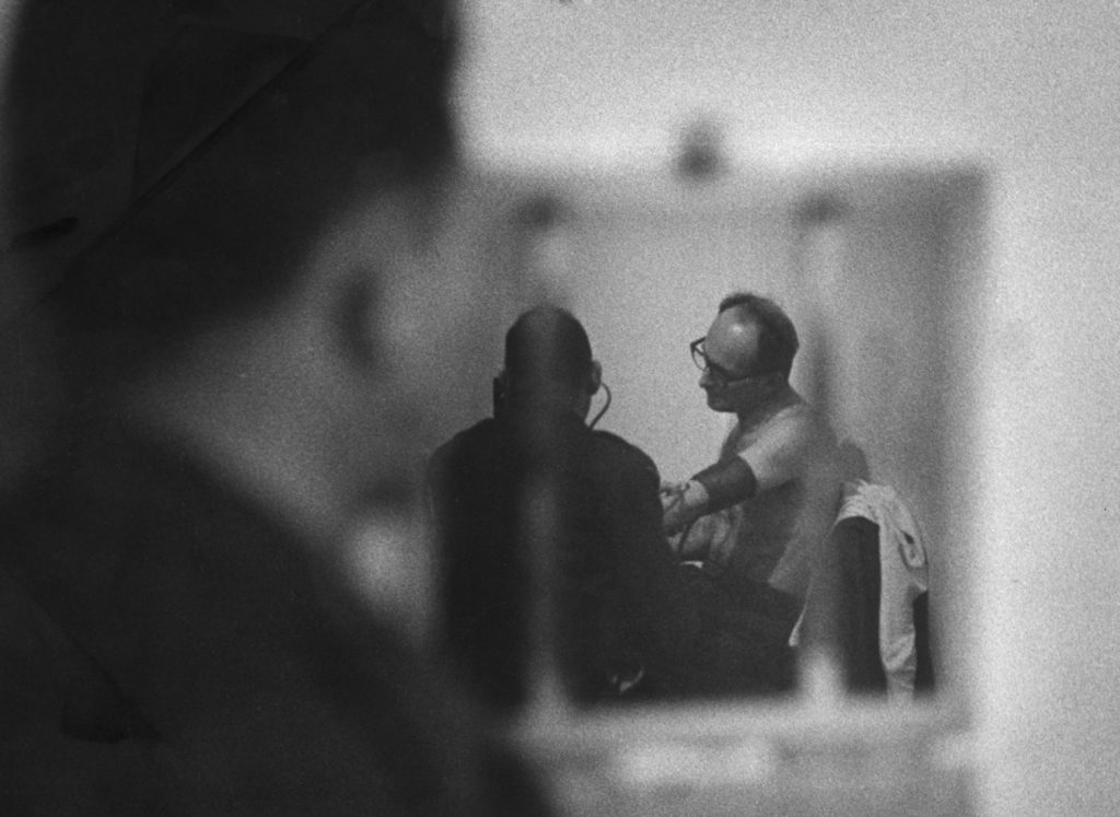 Adolf Eichmann awaits trial in Israel, 1961.
