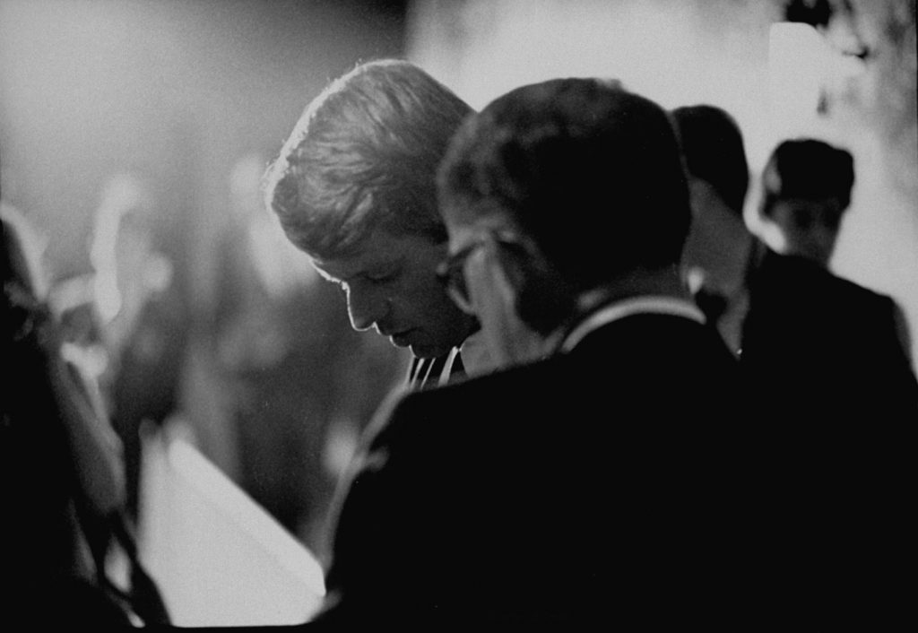 Sen. Robert Kennedy confers with an aide during his run for the Democratic presidential nomination in 1968.