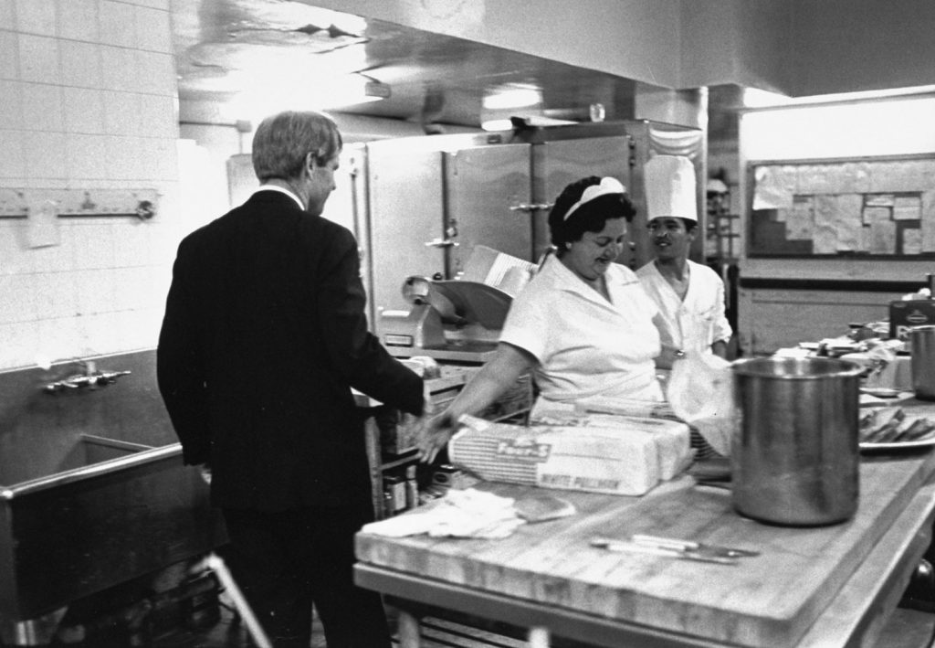 Heading for his victory speech in the Ambassador Hotel ballroom, Robert Kennedy stops in the kitchen to shake hands. A few minutes later the gunman was waiting for him in the corridor just outside the kitchen.