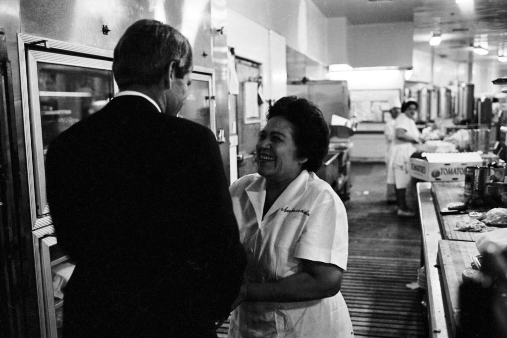 Heading for his victory speech in the Ambassador Hotel ballroom, Robert Kennedy stops in the kitchen to shake hands.