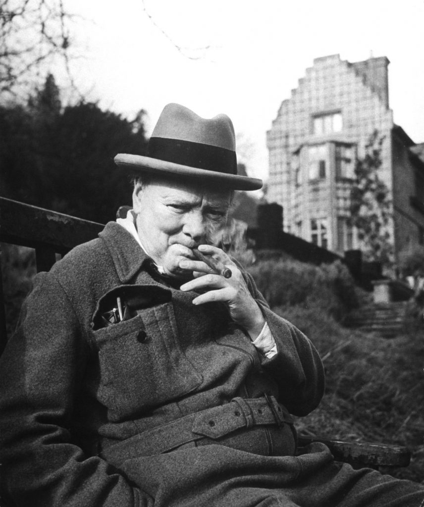 Winston Churchill smoking at cigar at his Chartwell home in 1947