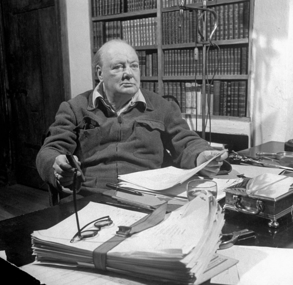 Winston Churchill at his desk working on his memoirs, March 1947