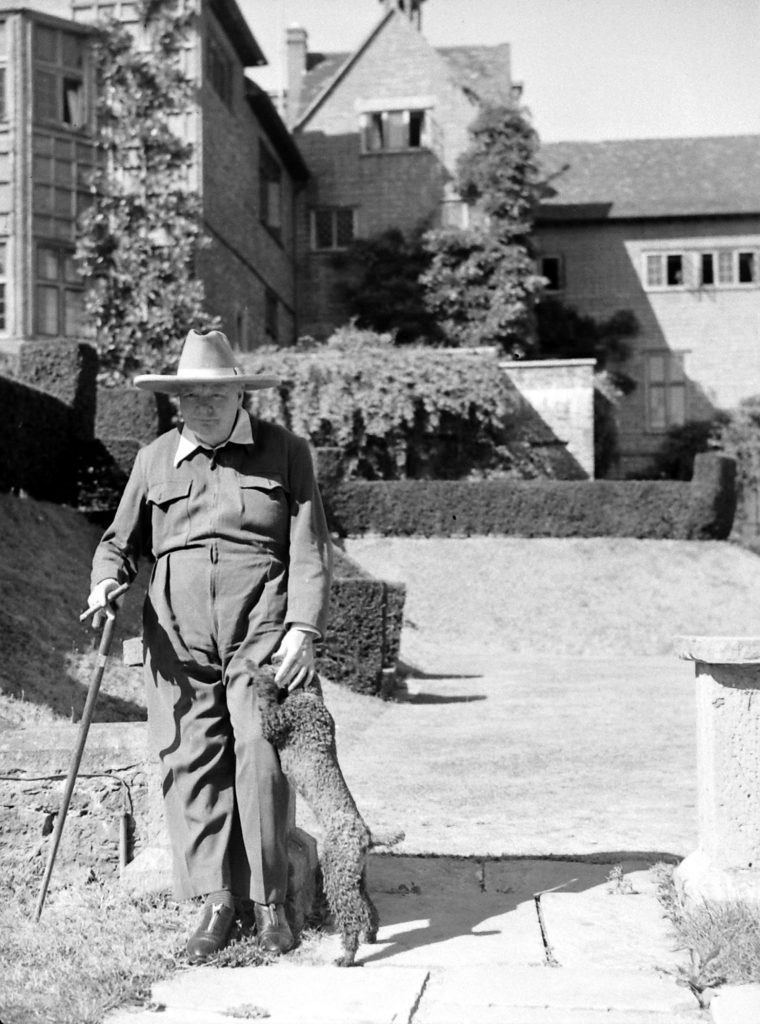 Winston Churchill and his dog, Rufus, at Chartwell in 1947.