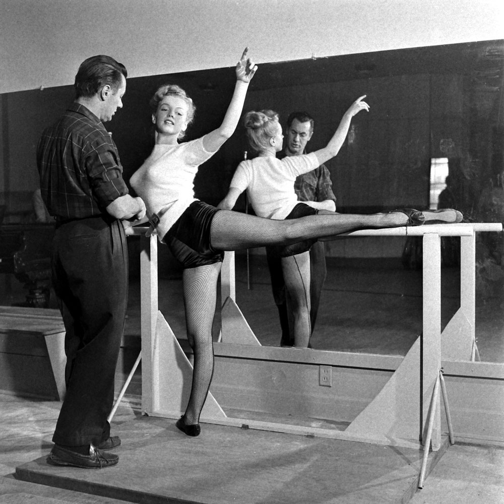 Marilyn Monroe, 22, takes dance lessons, Hollywood, 1949. Her instructor is Nico Charisse, ex-husband of the actress and dancer, Cyd Charisse.