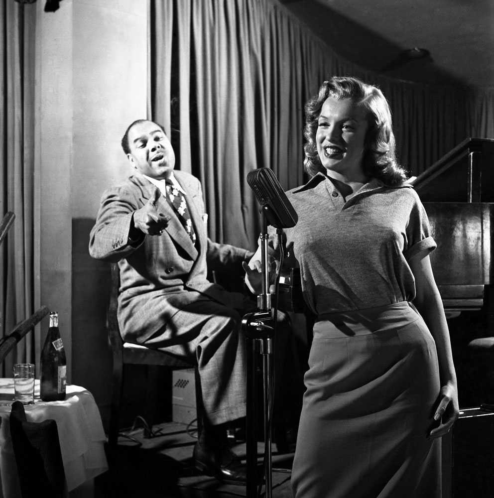 Marilyn Monroe, 22, takes singing lessons with bandleader Phil Moore at the famous West Hollywood nightclub, the Mocambo, in 1949.