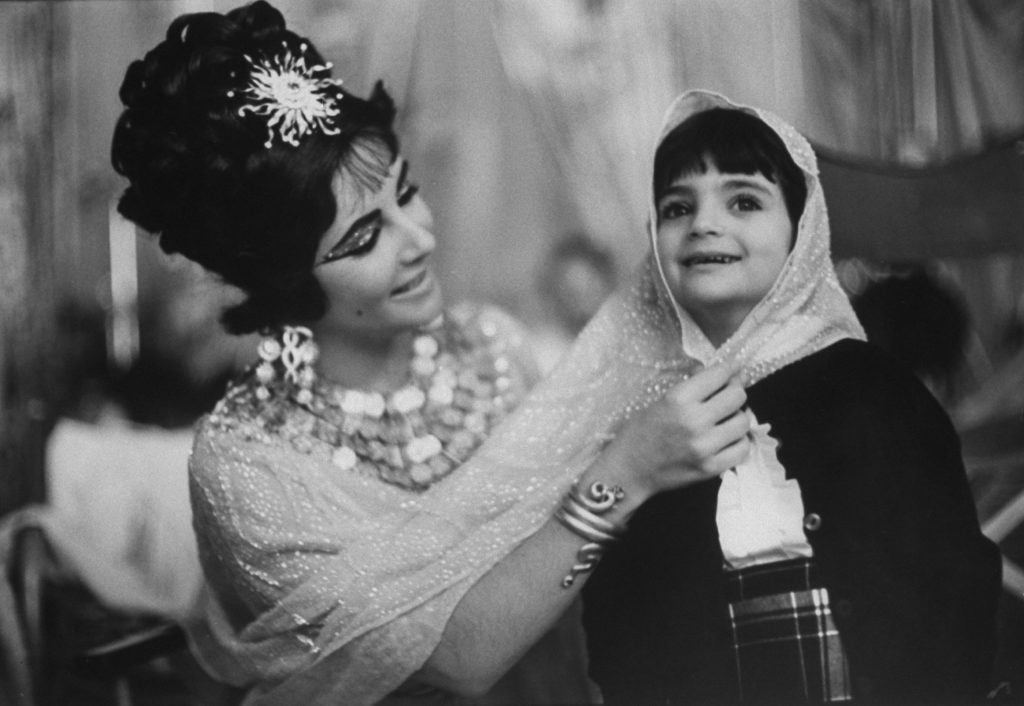 Elizabeth Taylor on the set of Cleopatra with her daughter, Elizabeth Frances, in Rome in 1962.