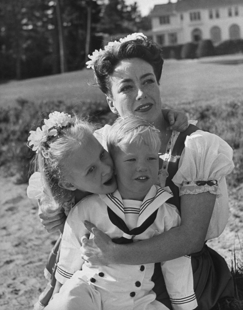 Actress Joan Crawford and her two adopted children on the beach, Monterey, California, 1945.