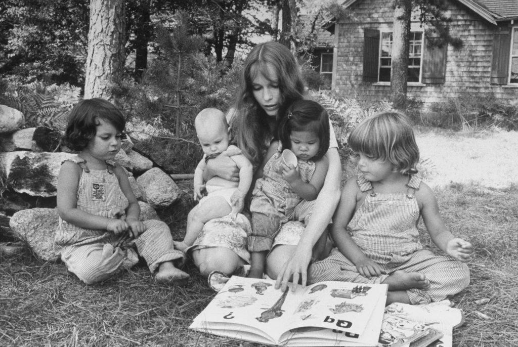 Mia Farrow reads to her children on Martha's Vineyard in 1974.