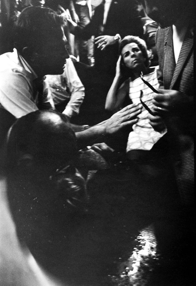 Mrs. Robert Kennedy and others surround a mortally wounded Robert Kennedy in the kitchen at the Ambassador Hotel, June 1968.