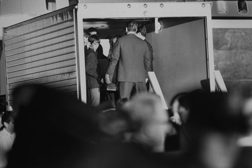 Robert Kennedy's body being loaded into a transport after his death and autopsy, prior to being shipped from Los Angeles to New York, June 6, 1968.