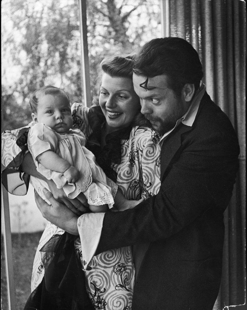 Orson Welles, wife Rita Hayworth and daughter Rebecca at home in 1945.