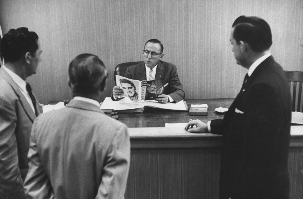 """Civic leaders meet with a Jacksonville, Fla. judge to discuss ways of """"curbing"""" Elvis Presley's influence on local teens, 1956."""