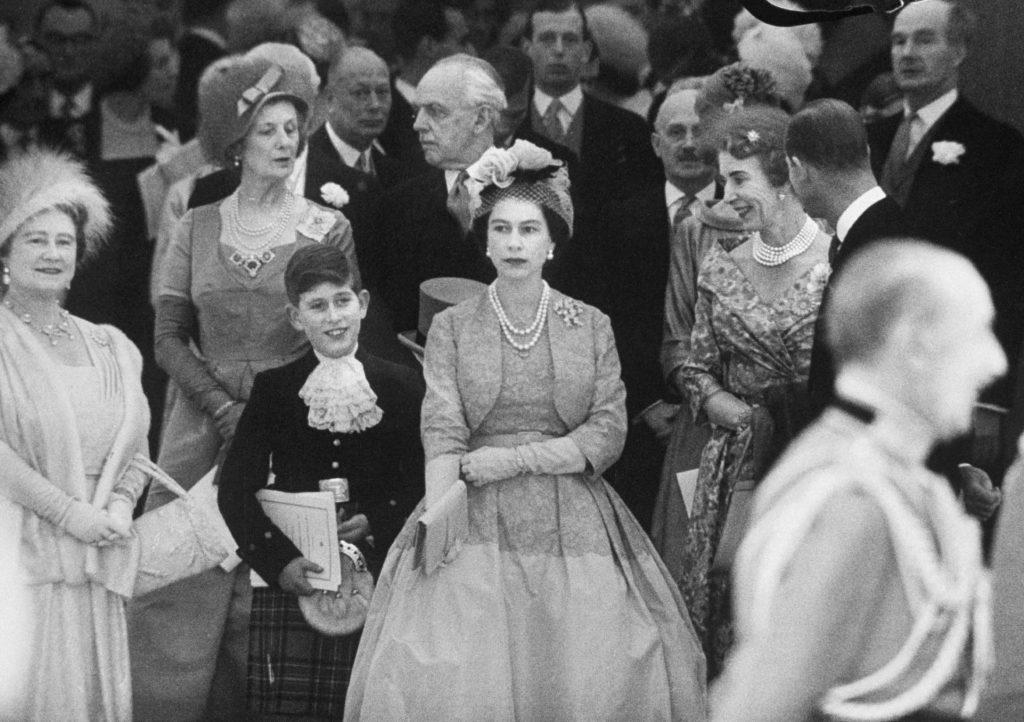 Queen Elizabeth with Prince Charles and Elizabeth II at Princess Margaret's wedding, 1960.