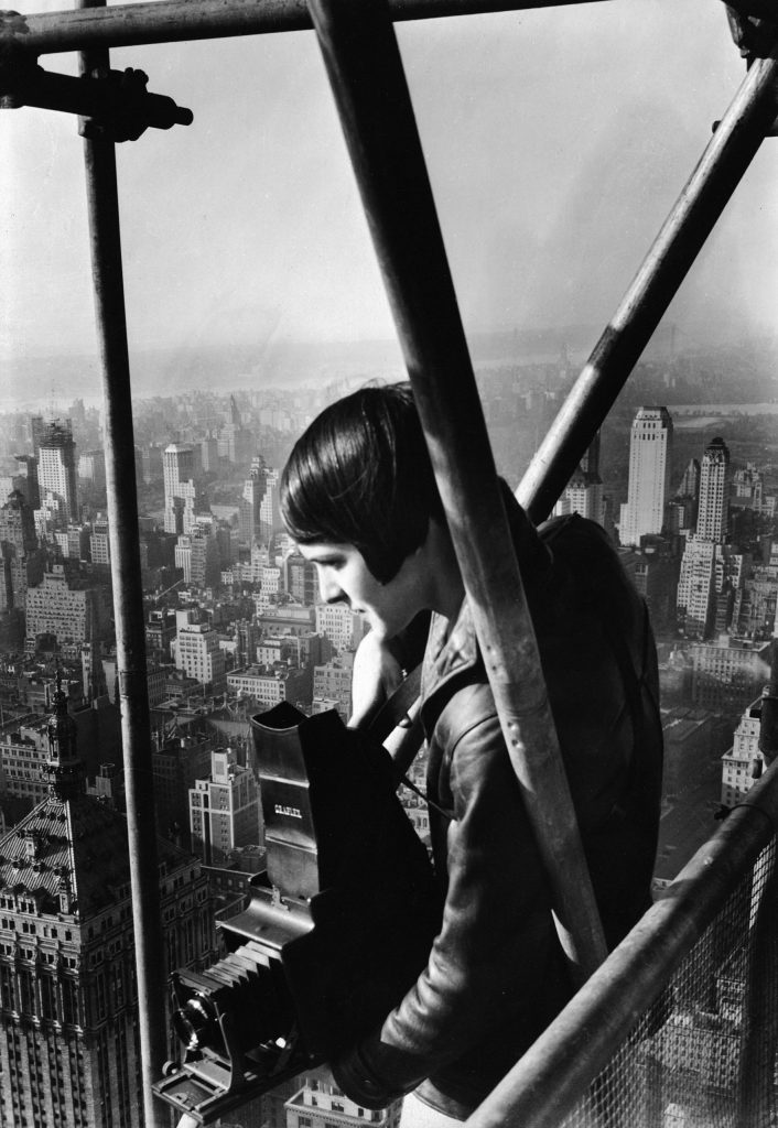 Margaret Bourke-White, 27, stands on the scaffolding enclosing the under-construction Chrysler Building in New York, 1931.