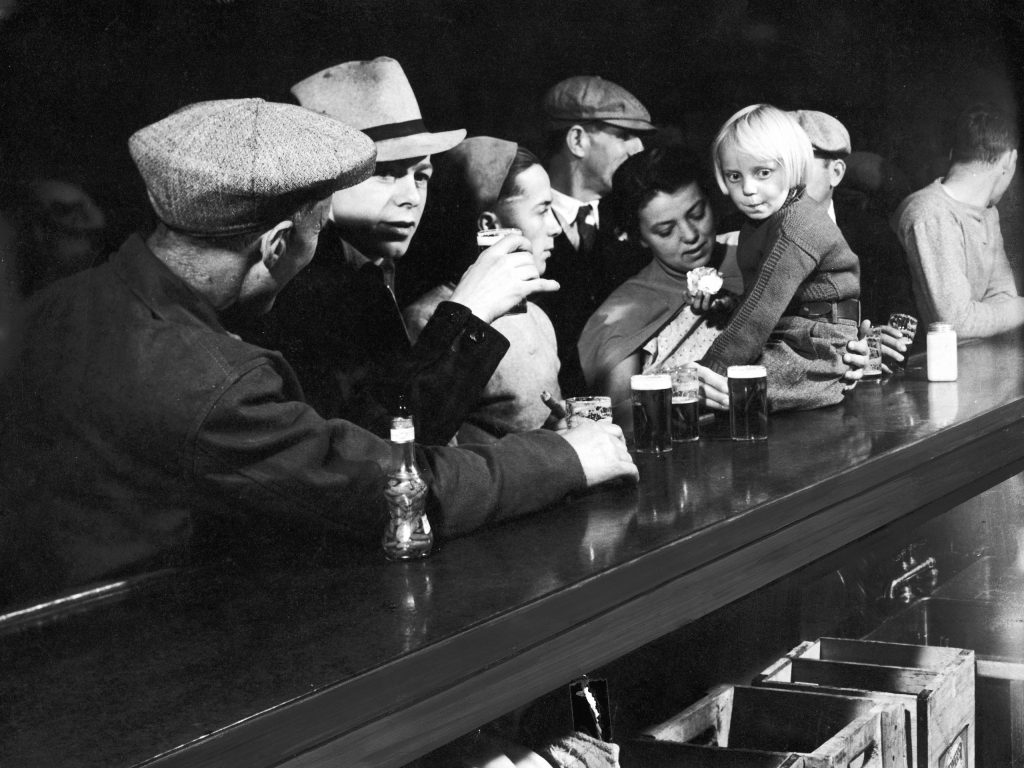 Scene at a dam-workers' Montana bar from LIFE's first issue, 1936.