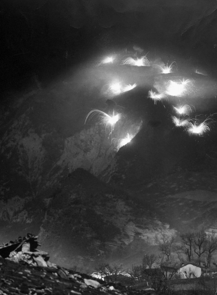 An Allied artillery barrage at night, the Italian front, 1944.