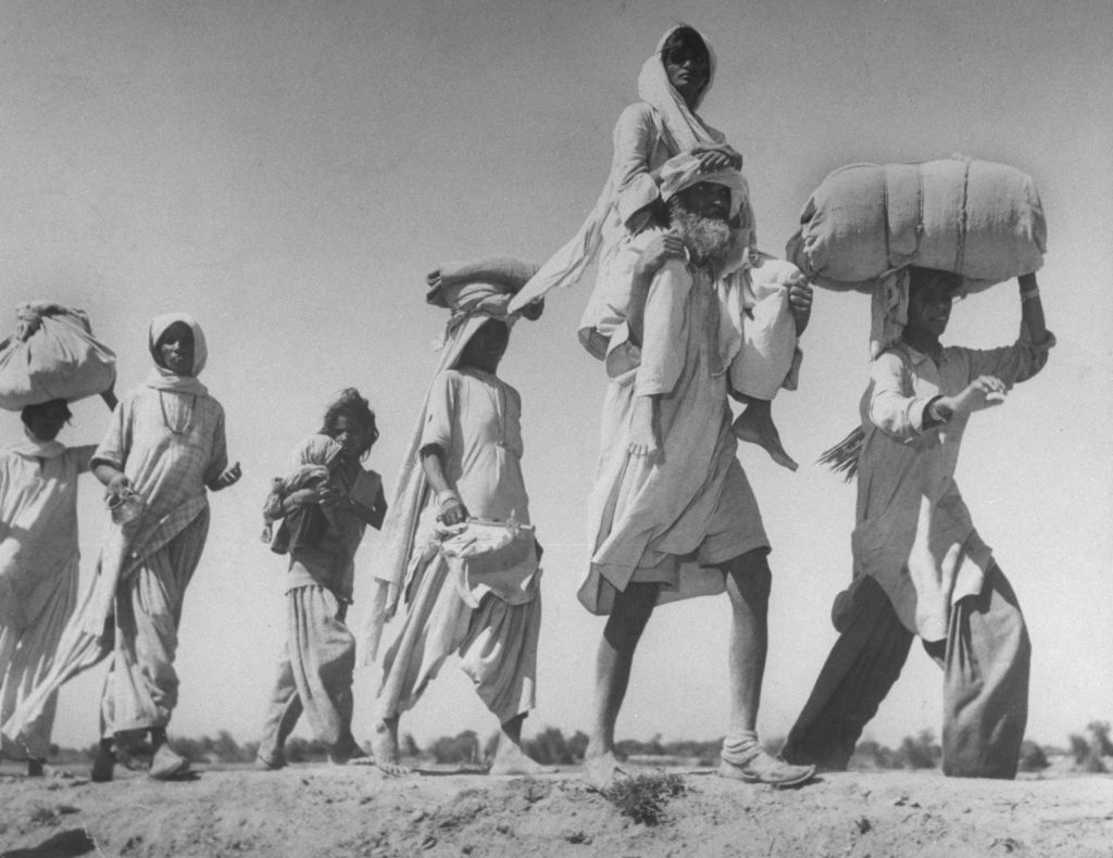 Hindus flee Pakistan in the midst of a border war, 1947.