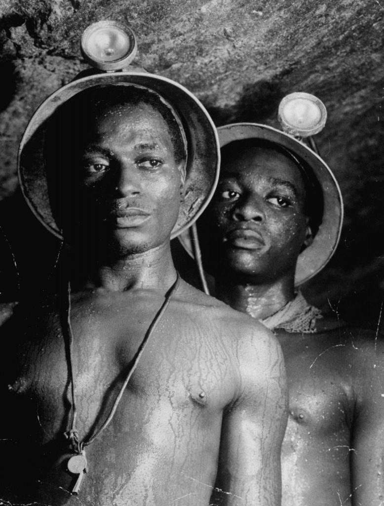 South African gold miners, photographed more than a mile underground, 1950.