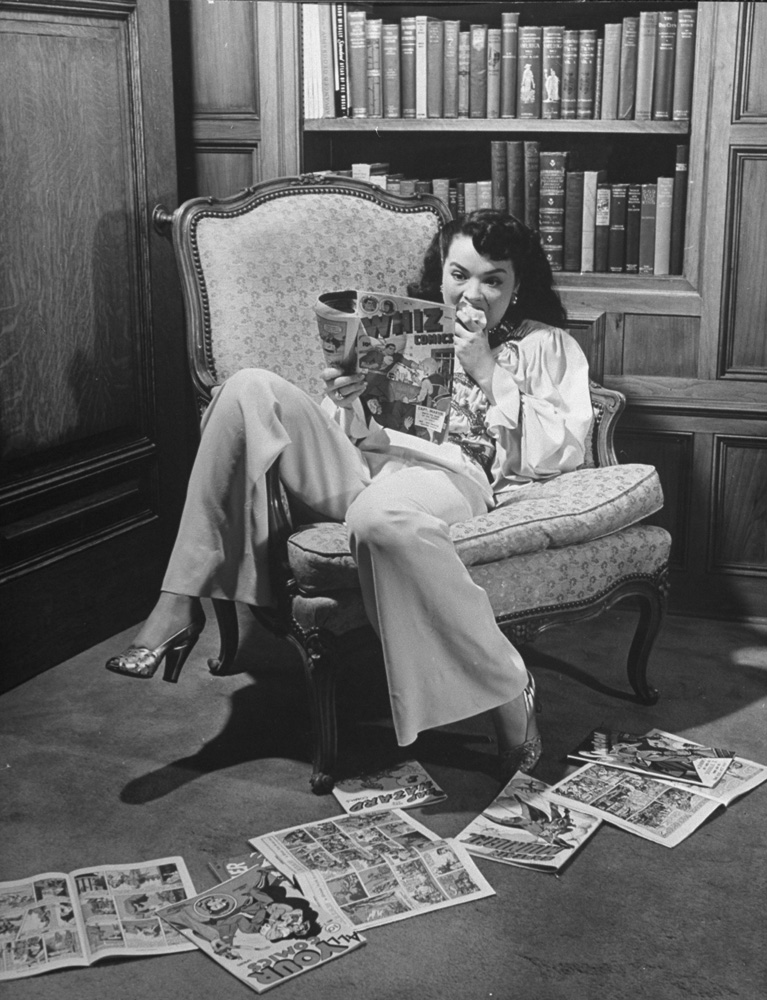Actress Buff Cobb (one-time wife of journalist Mike Wallace) reads comic books at home in 1946.