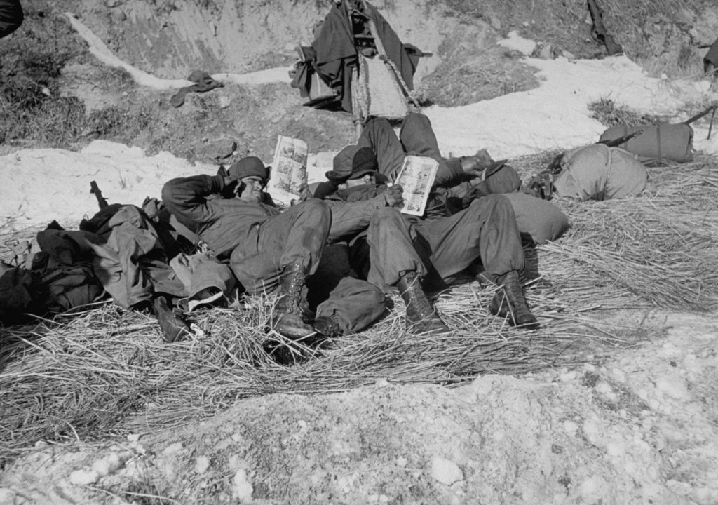 American troops read comic books during the Korean War, 1951.