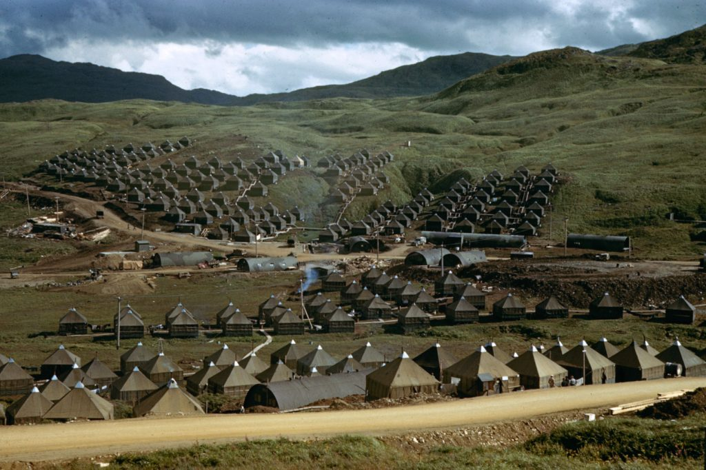 Tents housing Seabees (members of the U.S. Navy's Construction Battalion), Adak Island during World War II, 1943. Among the first to land on Adak, Attu, Kiska and Amchitka, the Seabees -- carpenters, mechanics, electricians, welders boilerman, and plumbers -- built airfields, roads, barracks and wharves.