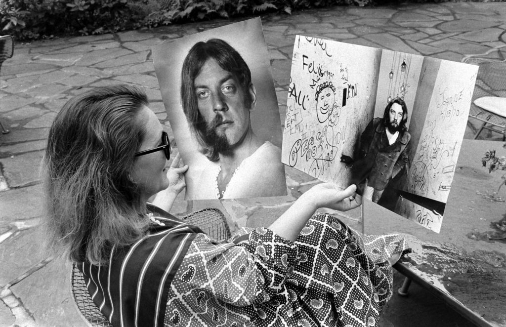 Shirley Douglas looks at pictures of her husband, Donald Sutherland, 1970.