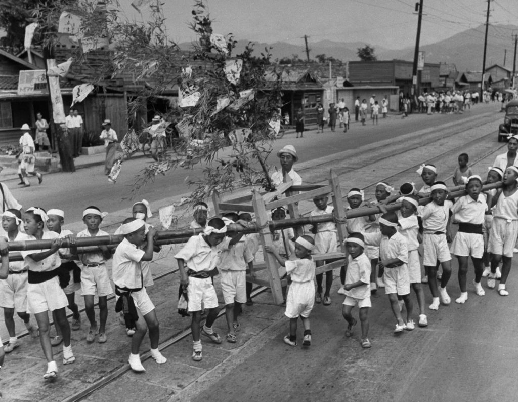 """A """"Peace Festival"""" in Hiroshima Japan, on the two-year anniversary of the United States' August 1945 atomic attack on the city"""