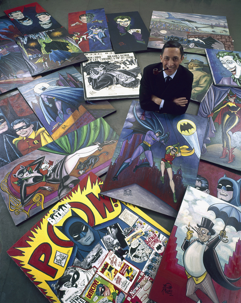Comic book artist Bob Kane, who created Batman, poses with his iconic illustrations, 1966.